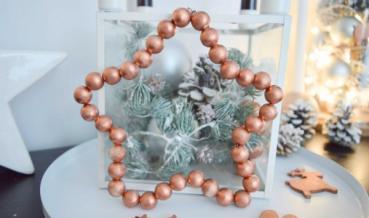 Karácsonyi csillag fagolyókból